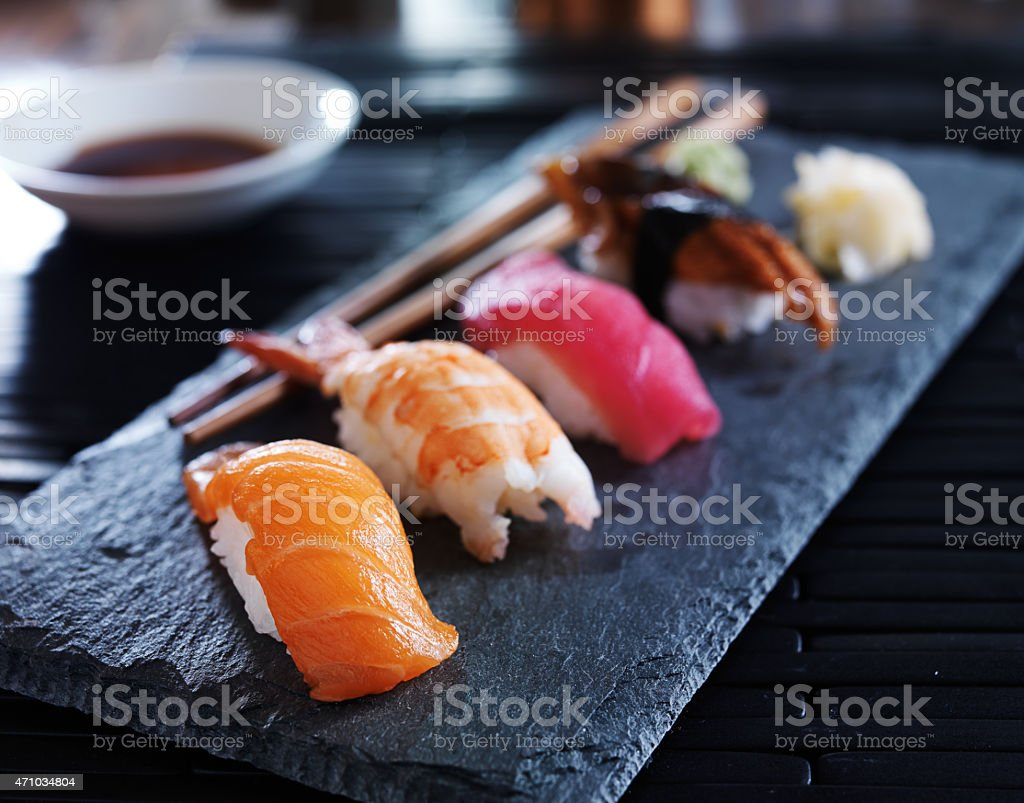 Close-up or assorted sushi nigiri on black slate stock photo