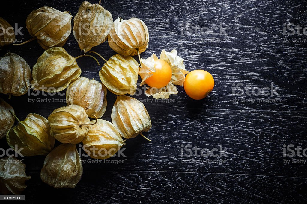 Closeup orange organic cape gooseberries on wooden background stock photo
