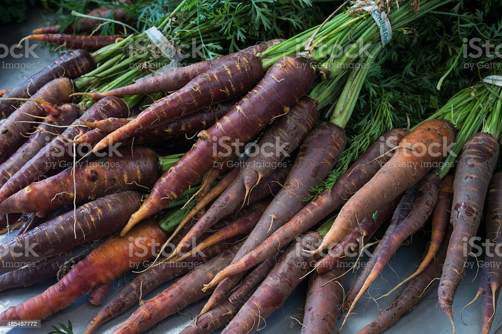 Close-up Organic Carrots at Small Farmer's Vegetable Stand stock photo