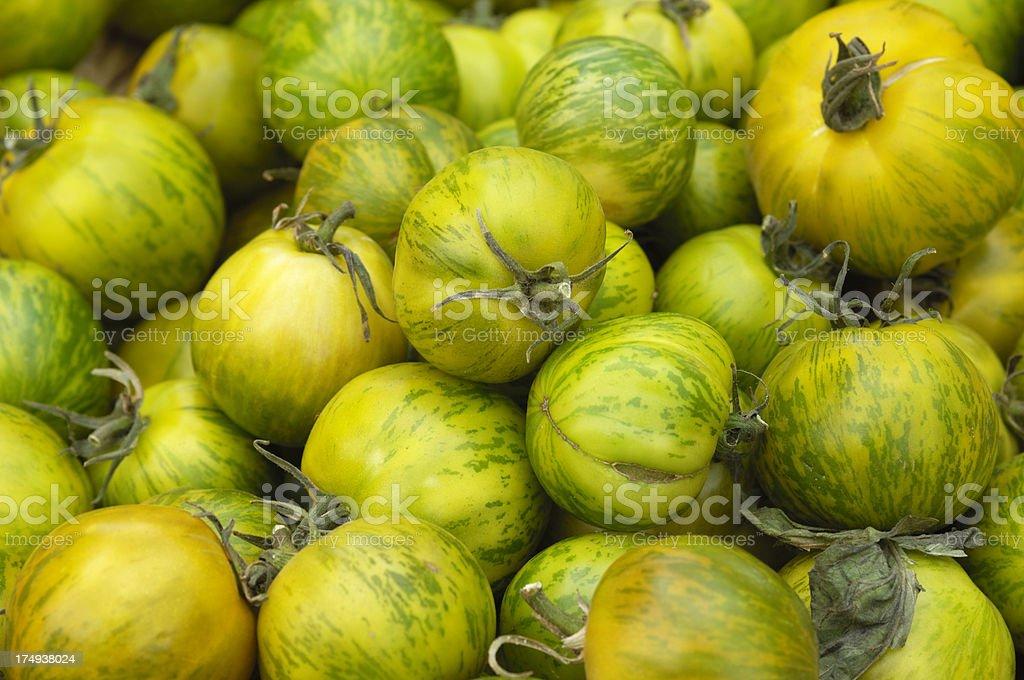 Close-up Organic Green Zebra Tomatoes on Display at Market stock photo