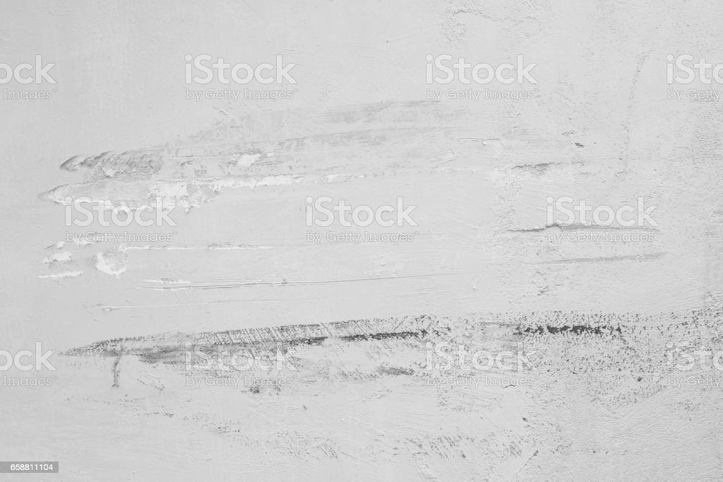 Closeup pale color and peeling of painted yellow cement wall textured background damaged by car in black and white tone stock photo