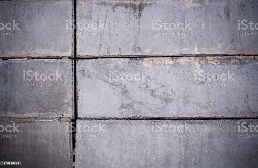 Close-up part of wall of gray concrete blocks. stock photo