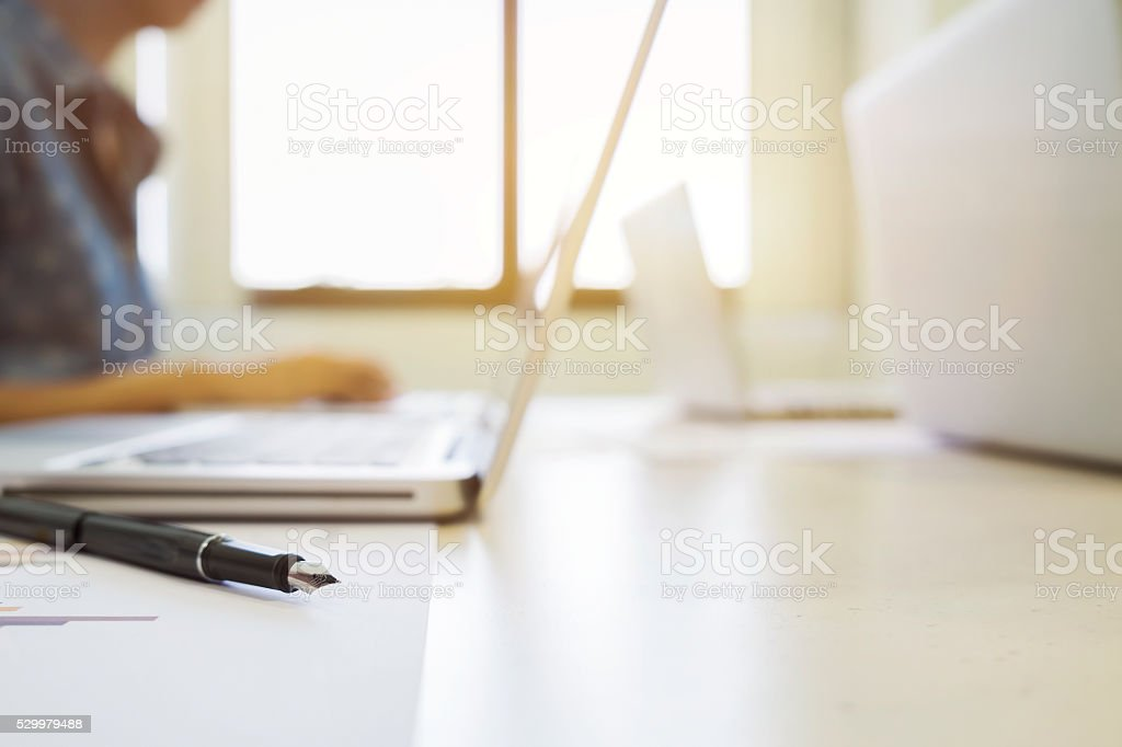 Closeup pen and blur background of  meeting startups business people. stock photo