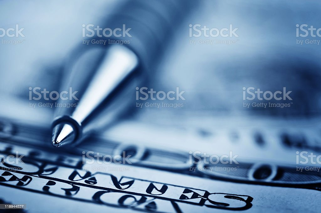 close-up pen on the money stock photo