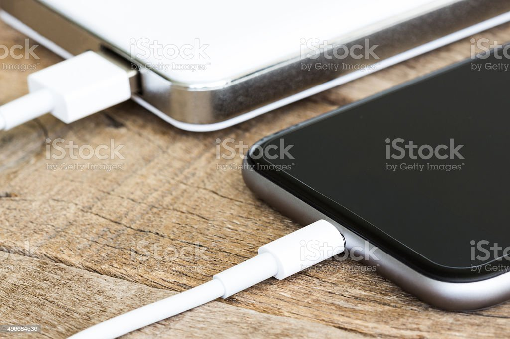 closeup phone charging white power bank portable device stock photo