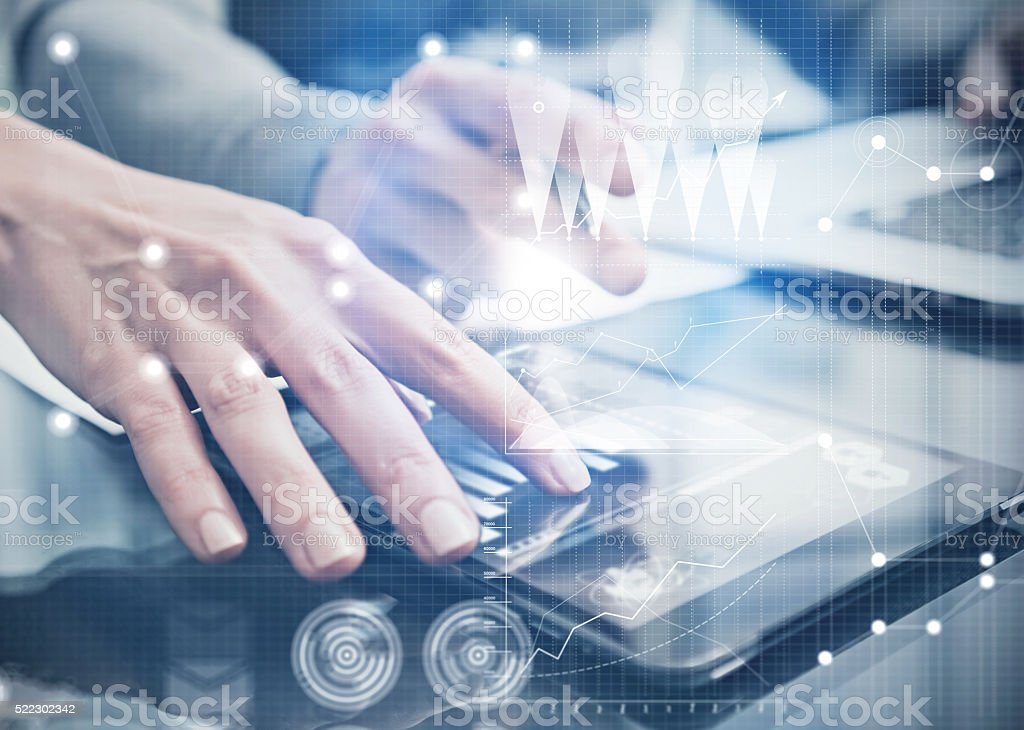 Closeup photo female hands touching screen modern tablet. Businessmans team stock photo