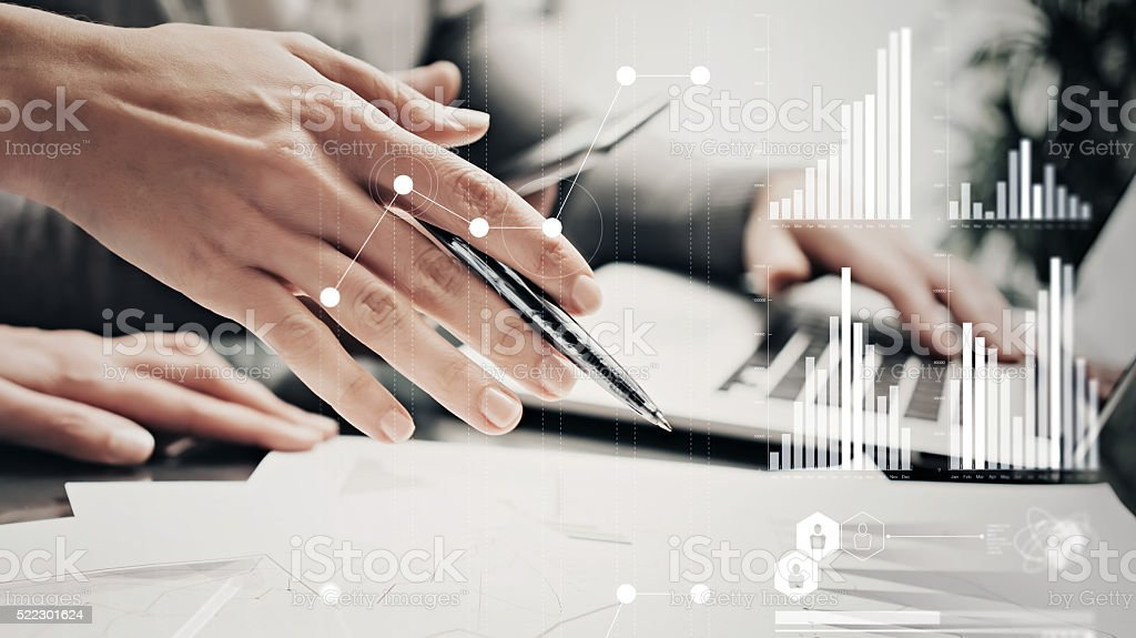 Closeup photo female hands with pen.Businessmans crew working bank stock photo
