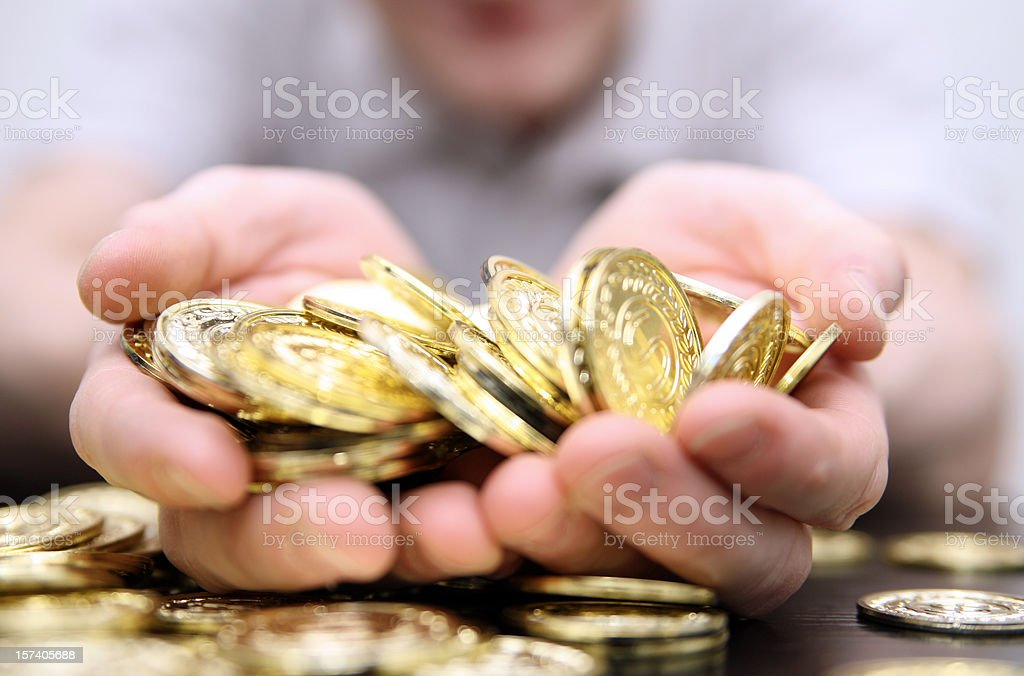 Close-up photo of a handful of gold coins royalty-free stock photo