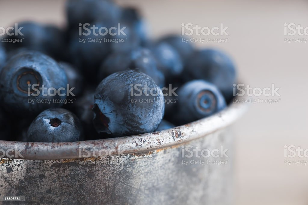 Close-up photo of a tin cup of blueberries stock photo