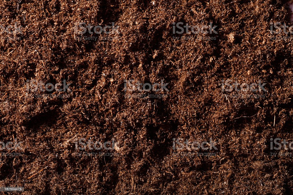 Close-up photo of brown tilled soil stock photo