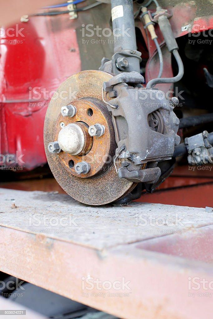 Closeup photo of car disc brakes servicing stock photo