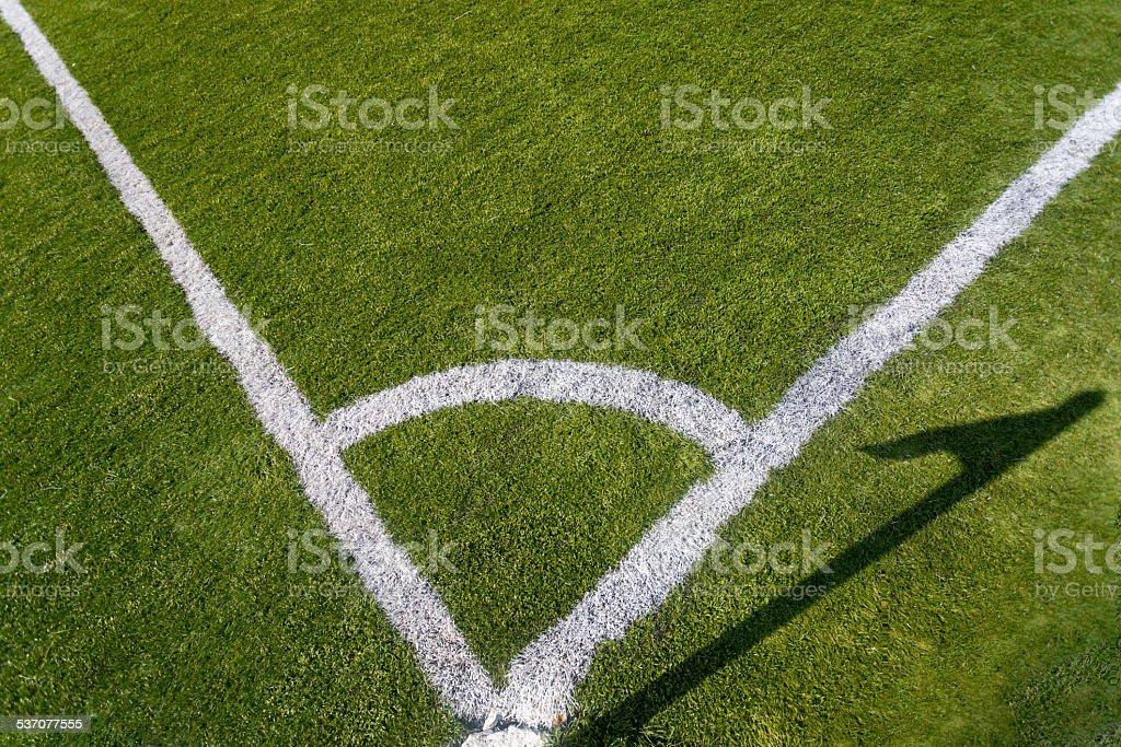 Closeup photo of corner marking on grass soccer field stock photo