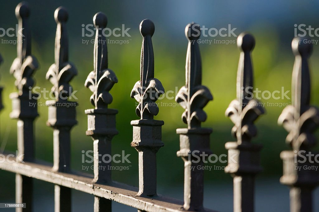 Close-up photo of dark wrought iron fence stock photo