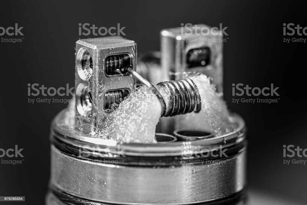 Closeup photo of dripping atomiser with coils stock photo