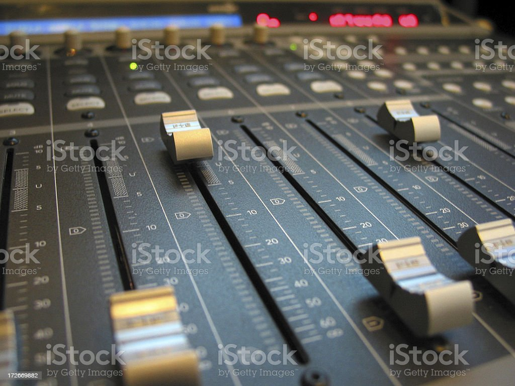 Close-up photo of fader switches on a soundboard stock photo