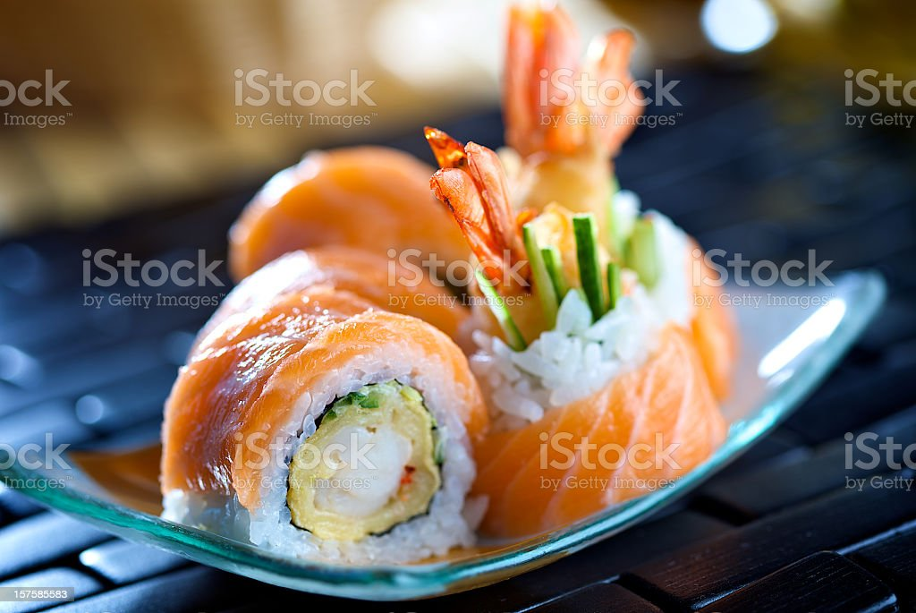 Close-up photo of Futomaki sushi on a blue plate stock photo