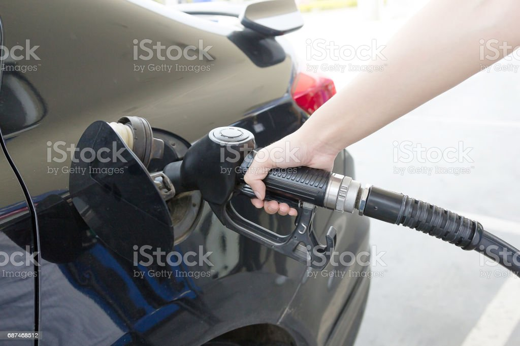 Close-up photo of hand holding fuel pump. stock photo