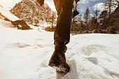 Closeup photo of human's legs going to the mountain