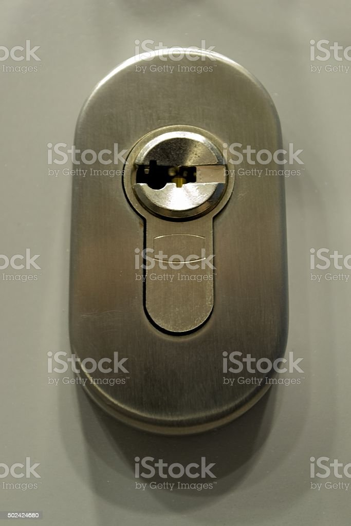 Close-up photo of keyhole in the door stock photo