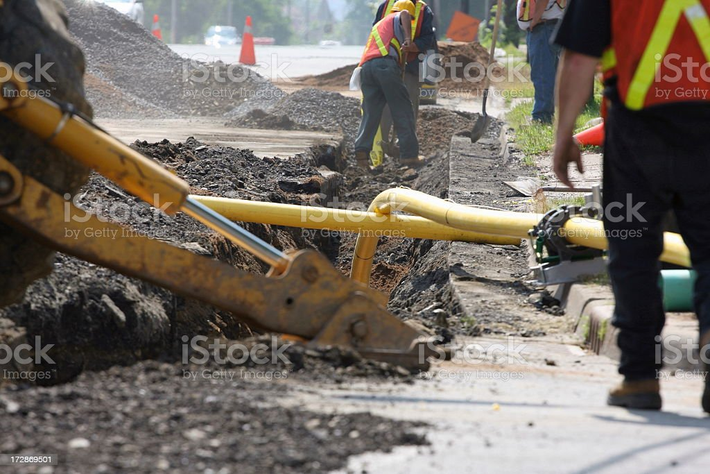 Close-up photo of machine installing a natural gas pipeline royalty-free stock photo