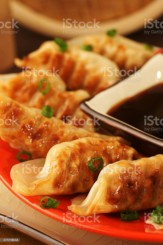Close-up photo of pot stickers arranged with sauce stock photo