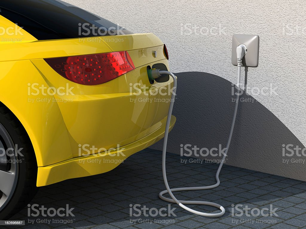 Closeup photo of rear of yellow car plugged into charger royalty-free stock photo