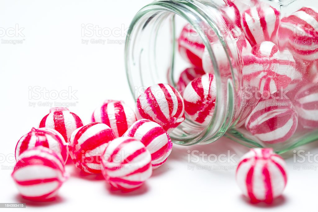 Close-up photo of red and white striped candies in a jar royalty-free stock photo