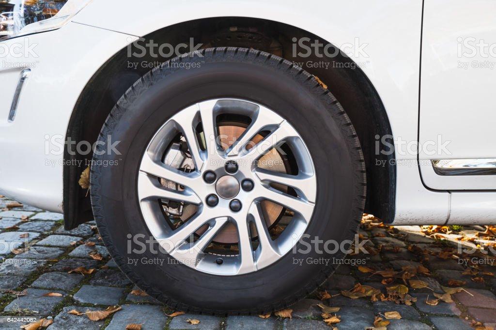 Closeup photo of white modern car wheel stock photo