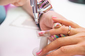 Close-up photo of woman's hand and manicure