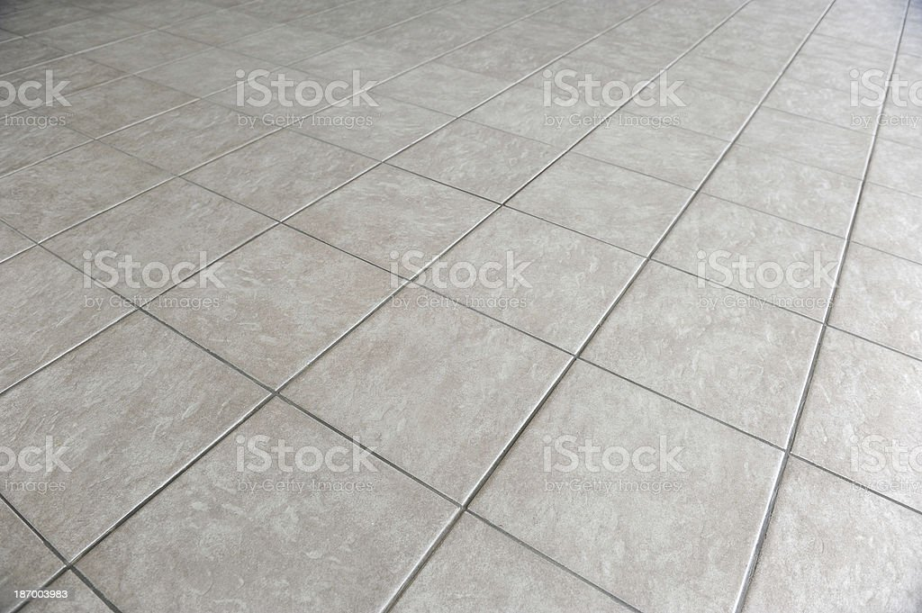 Close-up photograph of a gray tiled floor stock photo