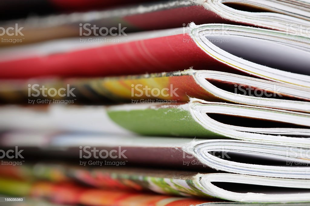 Close-up photograph of a stack of magazines royalty-free stock photo