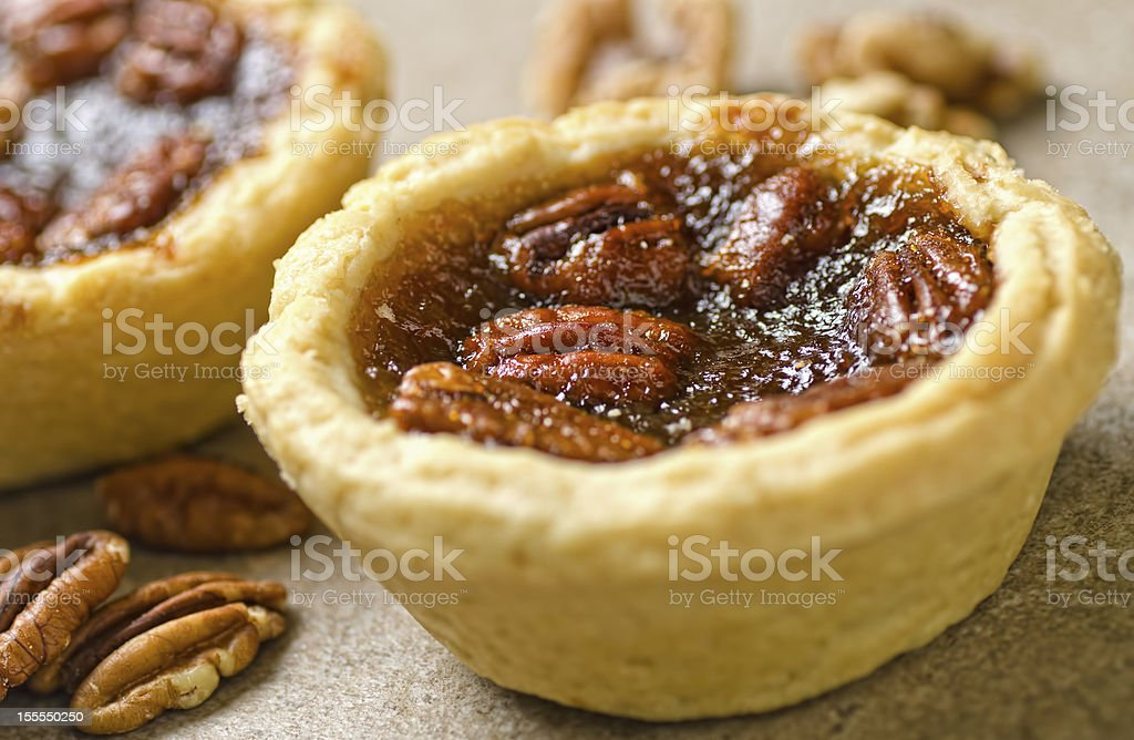 Close-up photograph of pecan tartlets and pecan nuts stock photo
