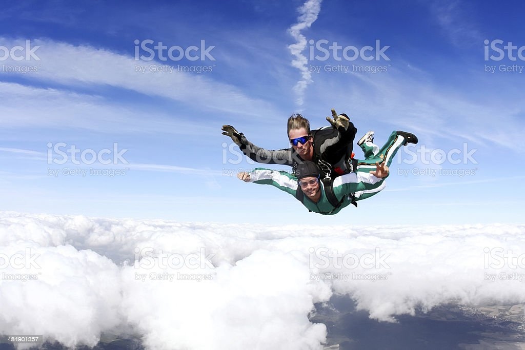 Closeup photograph of tandem skydiving royalty-free stock photo