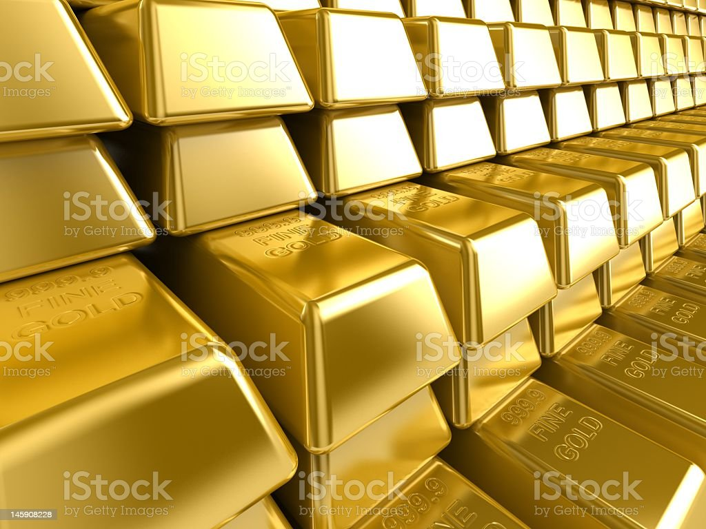 Close-up picture of gold bars stacked on top of each other stock photo