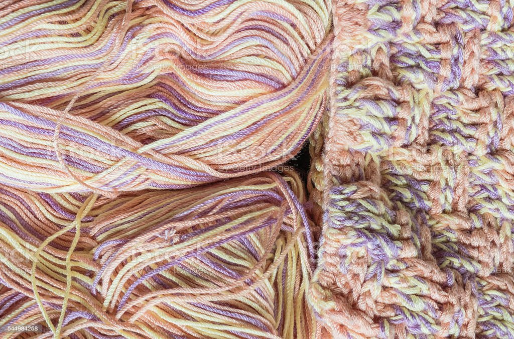 Closeup pile of colorful yarn texture background stock photo