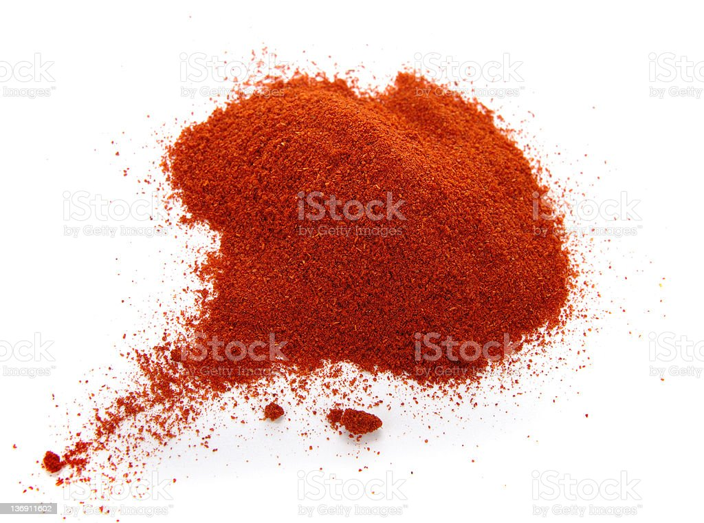 Close-up pile of red, ground paprika on white background stock photo