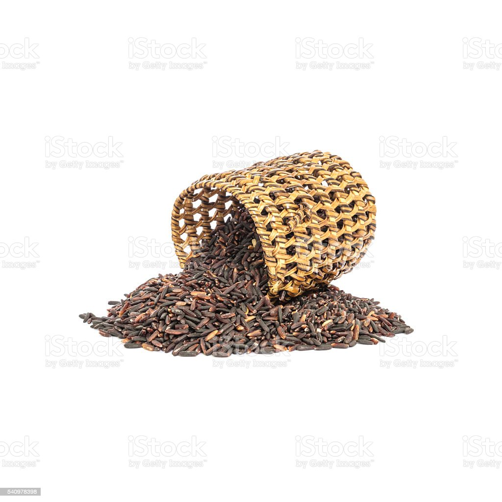 Closeup pile of riceberry rice with wooden wickerwork isolated stock photo