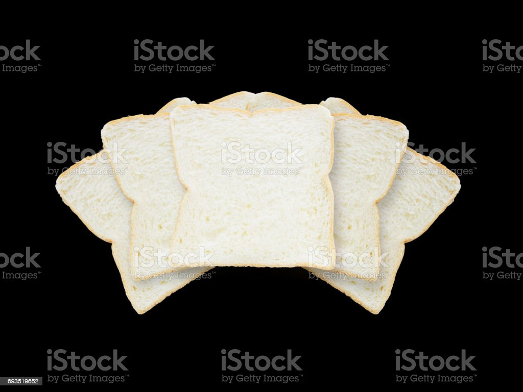 Closeup pile of slice bread for breakfast with shadow isolated on black background stock photo