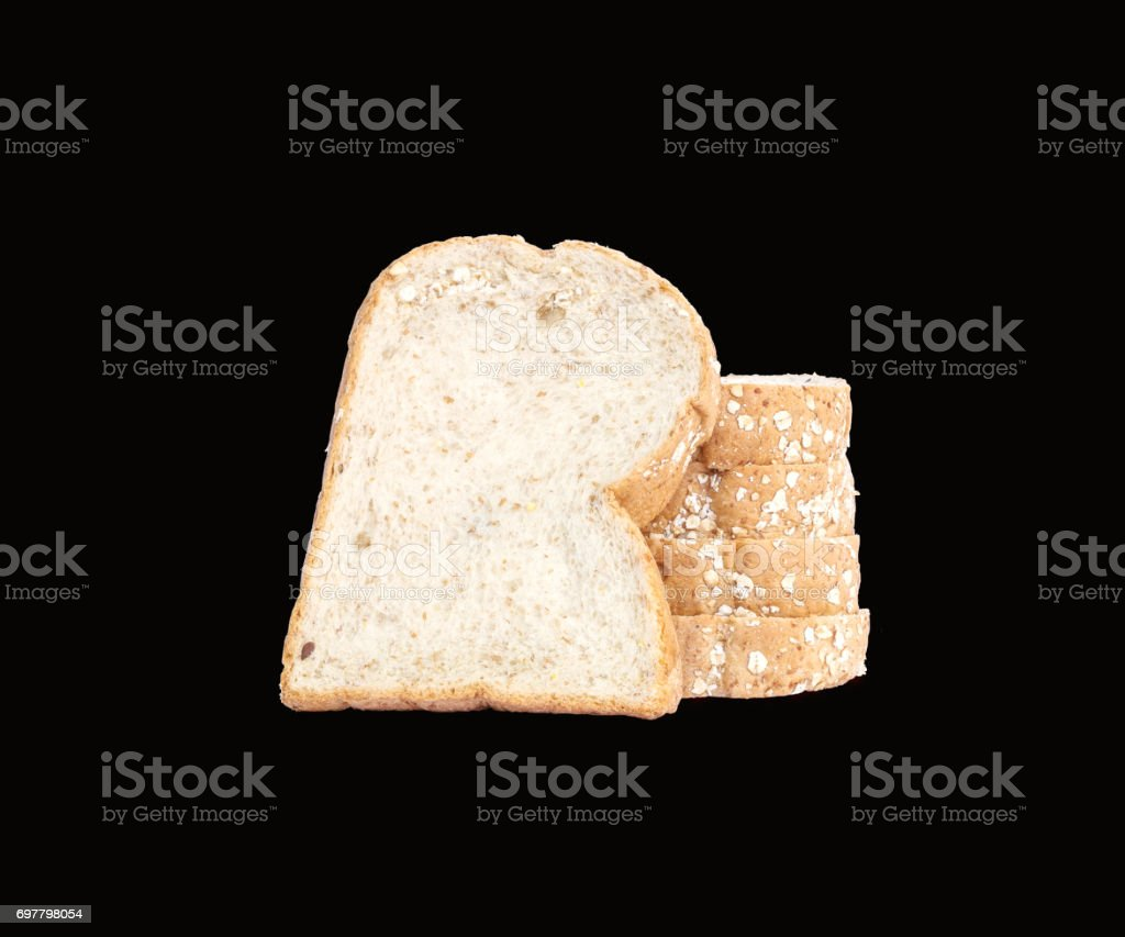Closeup pile of wheat bread for breakfast isolated on black background with clipping path stock photo