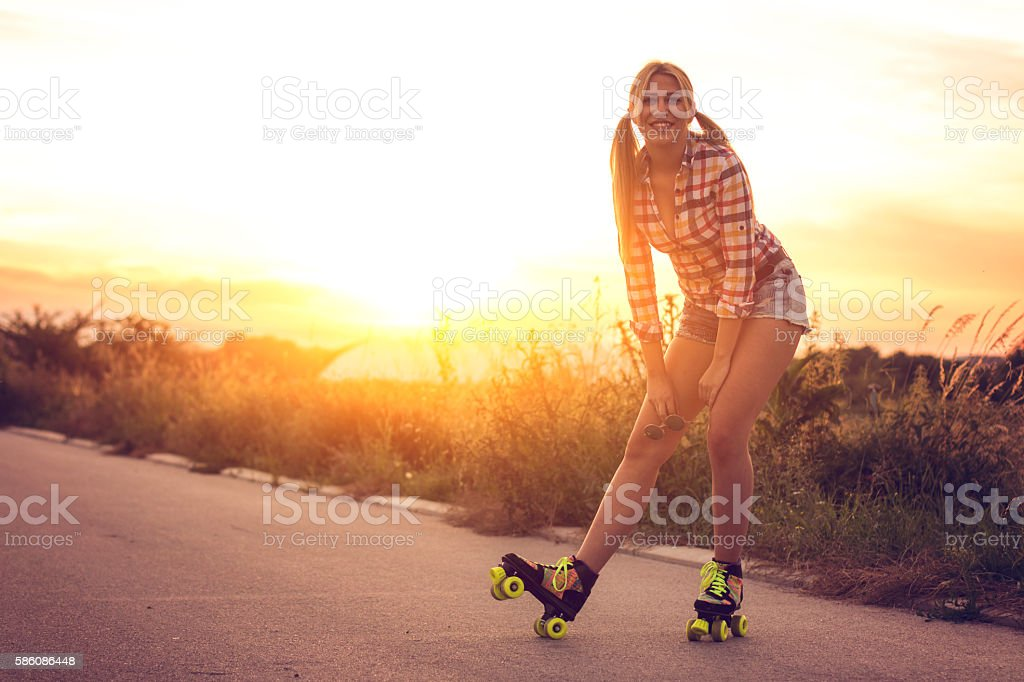 Closeup, pinup girl driving roller skates stock photo