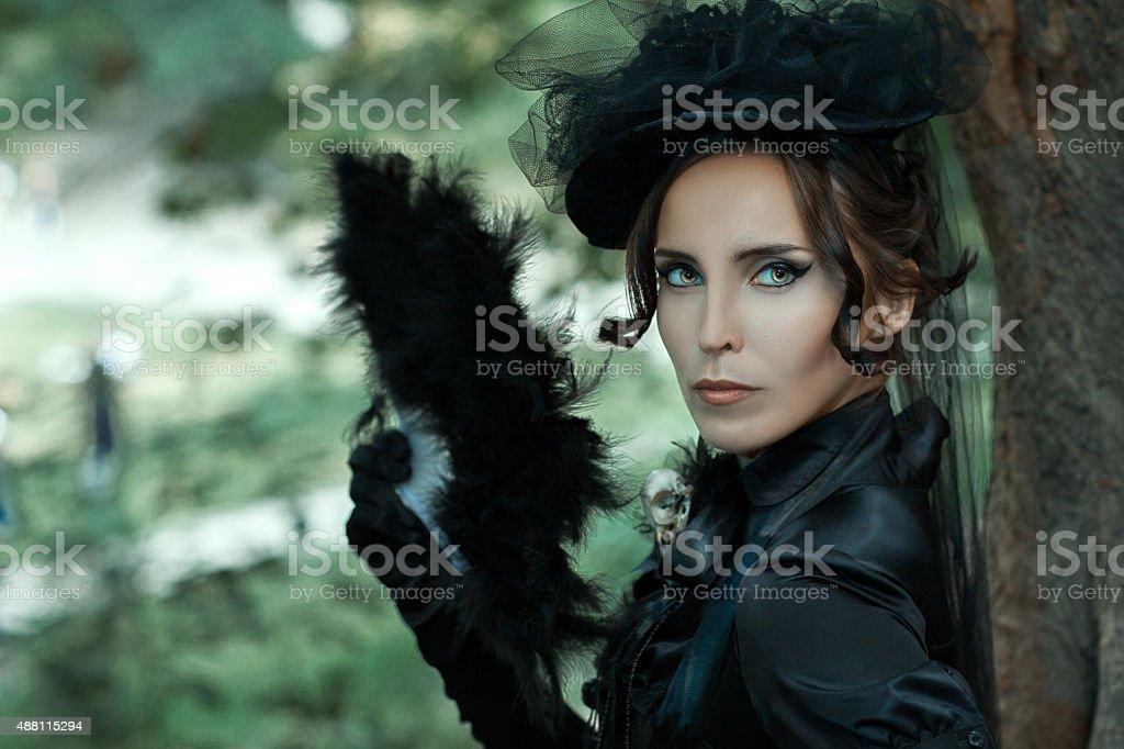 Closeup portrait girl in a black suit. stock photo