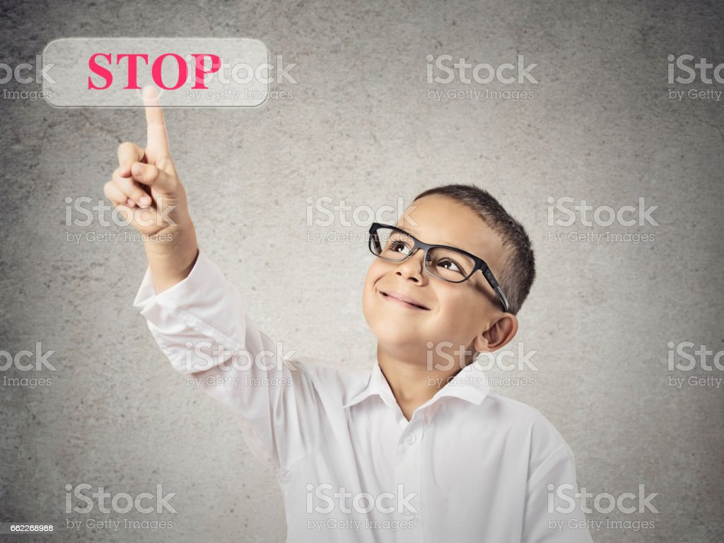 Closeup portrait happy boy with glasses pushing digital button stock photo