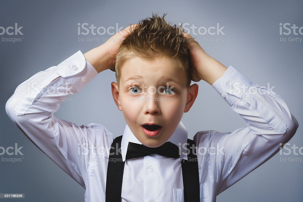 Closeup portrait headshot nervous anxious stressed afraid boy isolated grey stock photo