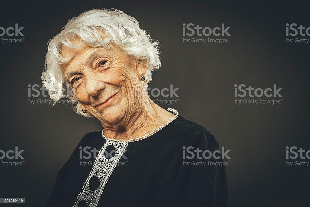 Close-up portrait of a beautiful senior lady stock photo