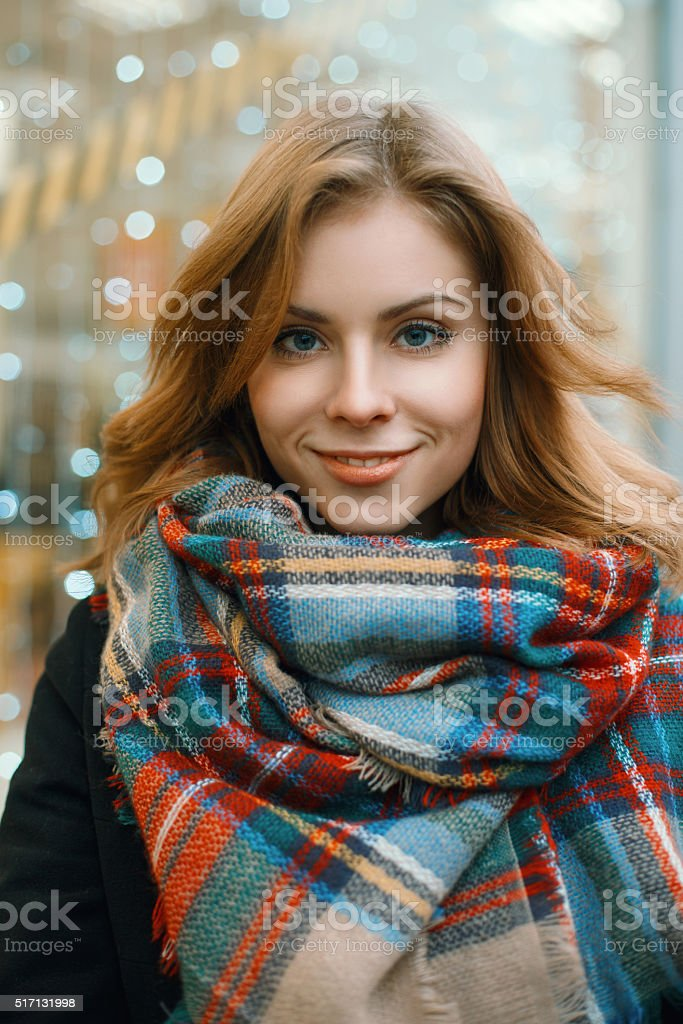 Close-up portrait of a beautiful woman in a stylish scarf stock photo
