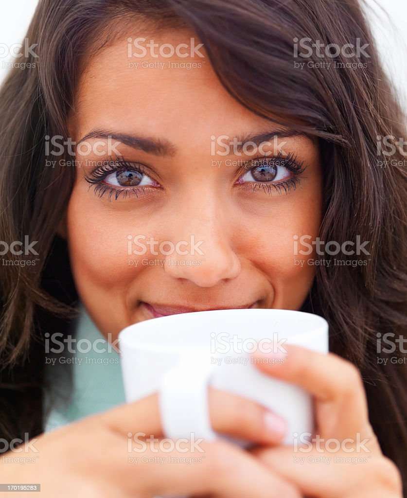 Closeup portrait of a beautiful young lady drinking coffee stock photo