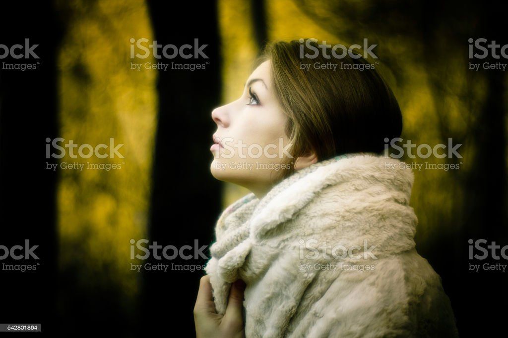 Close-up portrait of a beautiful young woman on blurry background stock photo