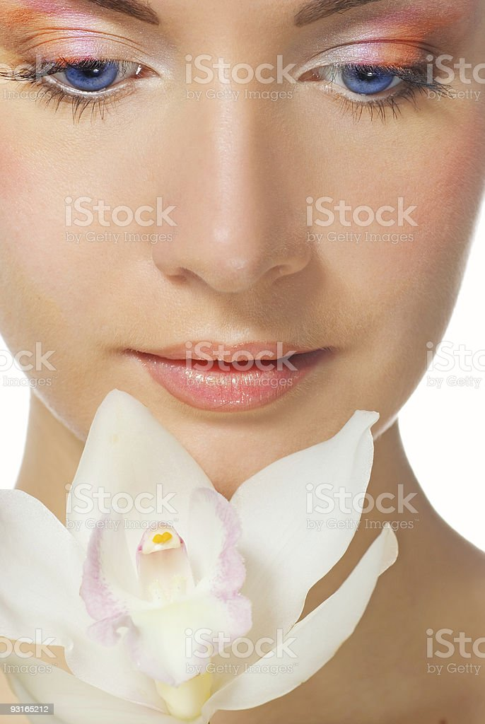 Close-up portrait of a beutiful girl with white orchid royalty-free stock photo