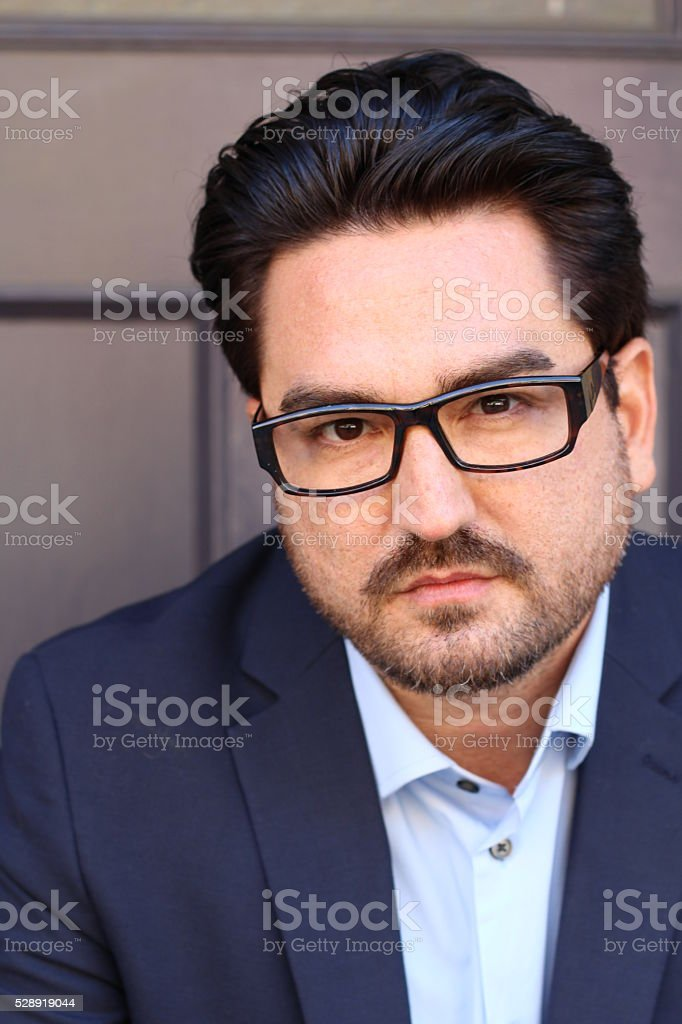 Closeup portrait of a businessman against purple background stock photo