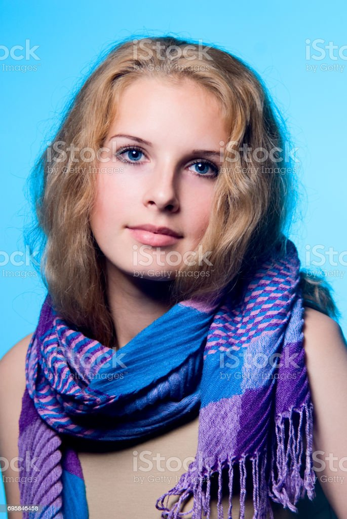Close-up portrait of a charming girl with a scarf stock photo
